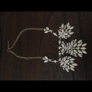 Jewelry - Gold and cream colored statement necklace.
